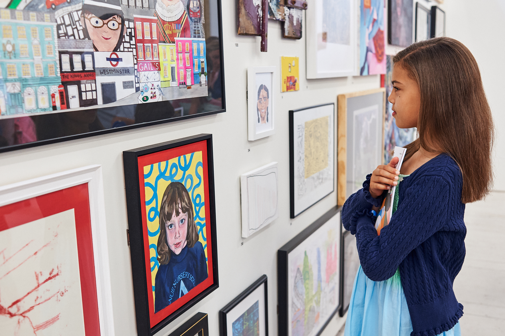 Eva, Year 5, views her work at the Royal Academy.