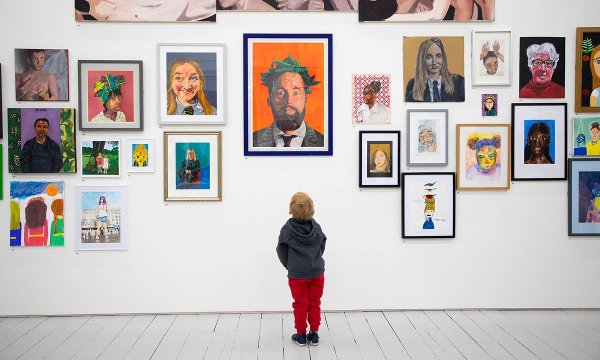 Eva, Year 5, views her work at the Royal Academy.>